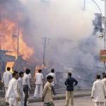 102809111750 riots 5 - fire engulfs houses.jpg