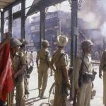 102909043551 riots 8 - properties burn as police watches.jpg