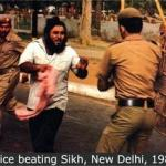 Police beating a Sikh.jpg