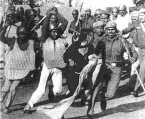 sikh women beaten by soldiers.jpg