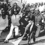 sikh women beaten by soldiers.jpg