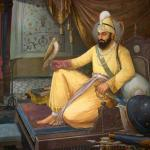 Guru gobind singh ji siting with baaj