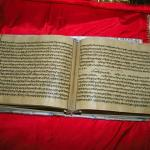 Hand Writer Guru Granth sahib red.jpg