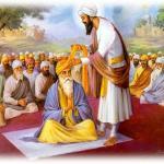 Guru_Angad_Dev_Ji_blessing_Guru_Amar_Das_Ji_with_Siropa.jpg