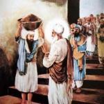 Guru Amardas ji blessing Ramdas ji who is carrying ma