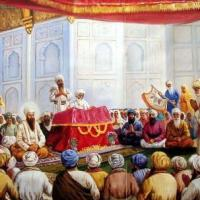 Guru Granth is Guru, Guru Arjan Dev sits next to Guru