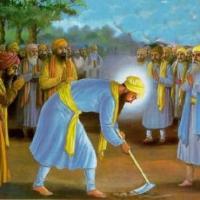 Guru Arjan Dev ji doing Kar sewa