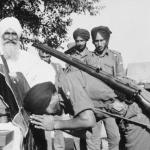 Armed Sikh Soldier bowing to Guru Granth Sahib ji